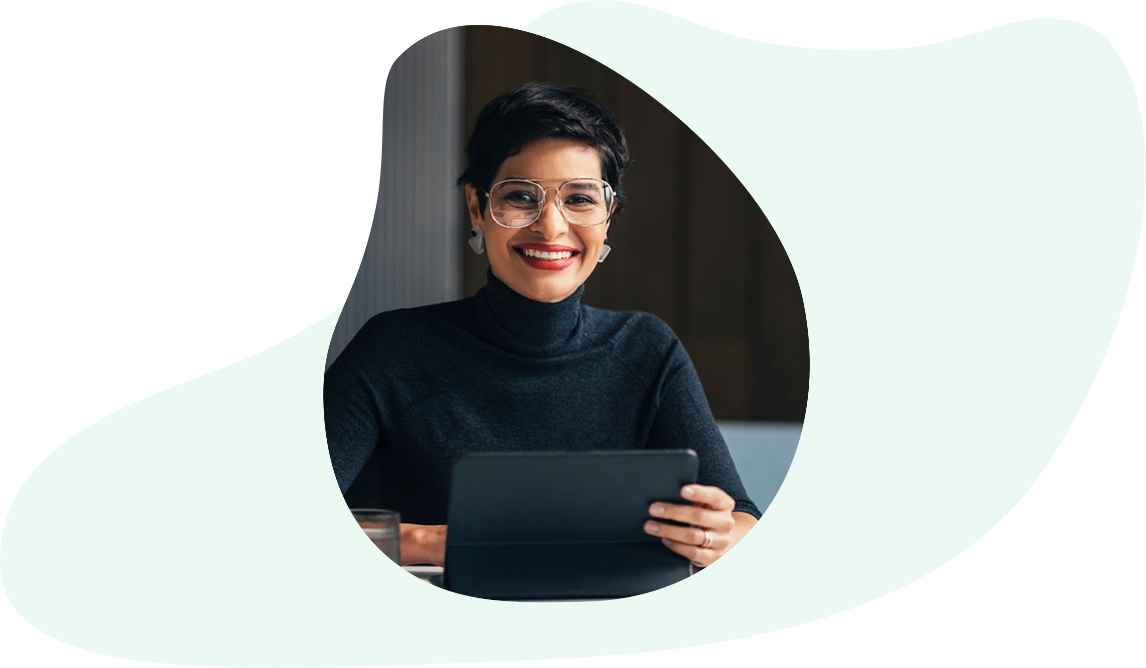 Professional woman holding a tablet and smiling